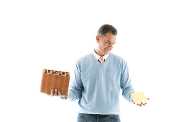 Man Holding brick and a gold bar