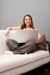 smiley woman sitting on sofa