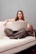 smiley woman sitting on sofa