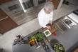 Mid- adult chef prepares salad, overview