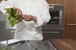 Mid- adult chef preparing radishes