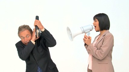 Asian businesswoman shouting at her employee