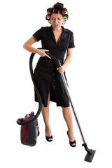housewife with a vacuum cleaner