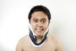 It's hurt,  A man using hard collar to cure neck pain.
