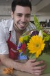 Florist stands with sunflower arrangement