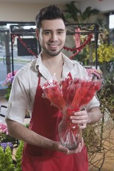 Florist stands with dried red flowers