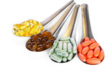 spoon with colorful vitamin medicine pills
