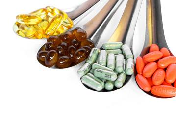 spoon with colorful vitamin medicine pills