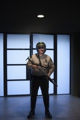 Nightwatch patrolman with rifle