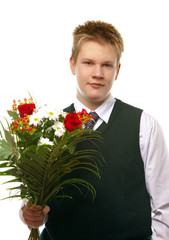 The pupil in a school uniform with a bouquet
