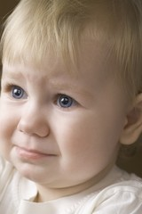 Blonde 14 month old on the verge of tears