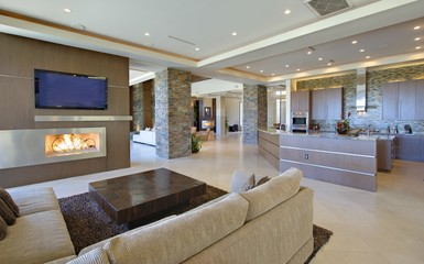 Open planned interior with furniture, a television and a kitchen
