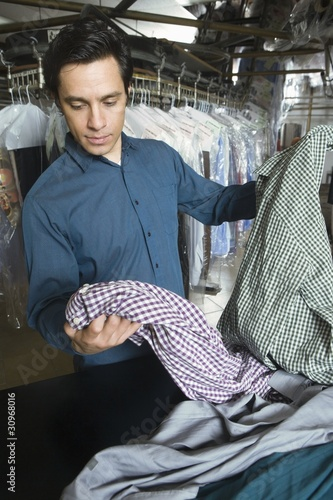 Man working in the laundrette