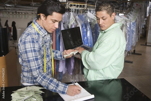 Two men working in the laundrette