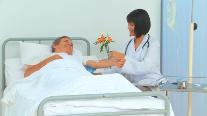 Nurse taking the blood pressure of her patient