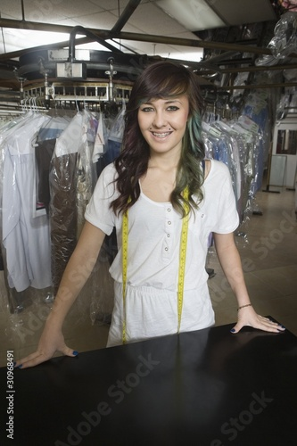 Young woman working in laundrette