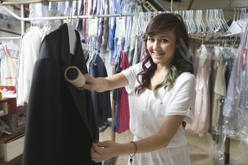 Woman working in the laundrette cleaning clothes