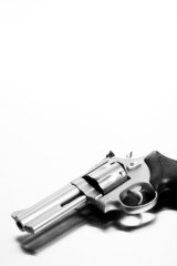 gun on steel surface - modern revolver handgun