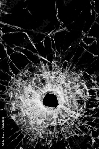 broken glass isolated on black - bullet hole gunshot