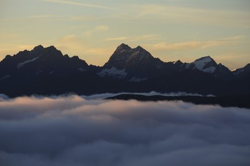 Marmolada Summit, Paraglider with Langkofel behind, Italy, Dolomites