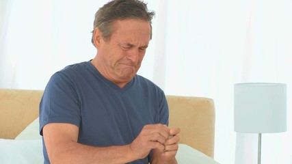 A sick man taking his pills