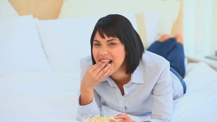 Chinese woman eating popcorn