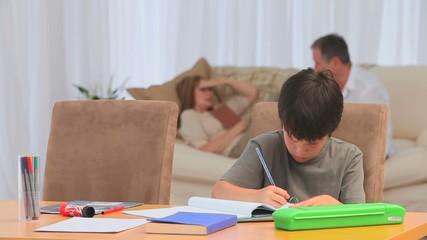 Little boy doing his homeworks after school