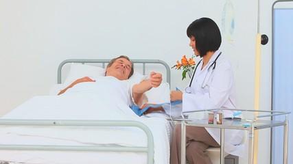 Asian nurse taking the blood pressure