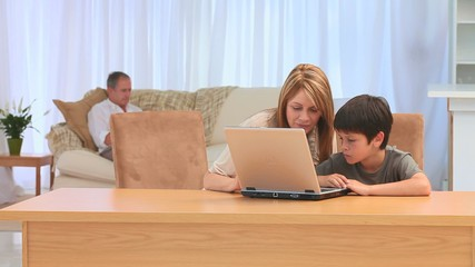 Grandmother and her grandson with a laptop