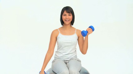 Asian woman with dumbbells