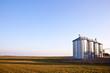silver silos in the field