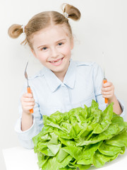 Vegetarian food - little girl with butterhead lettuce