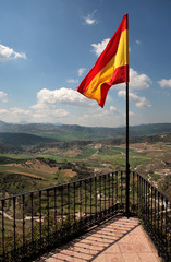 Spanish flag flying over the beautiful town of Ronda