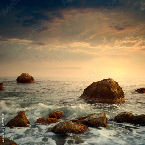 sunrise on rocky sea coast