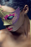 Closeup beauty portrait of a young woman wearing mask