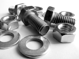 Fixing bolts, nuts and washers on a white background