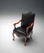 An empty black leather armchair