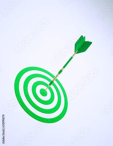 A green dart on an abstract dartboard