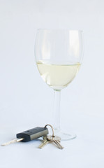 bunch of car keys and glass of white wine dont drink and drive