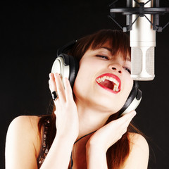 popstar woman singing to the microphone