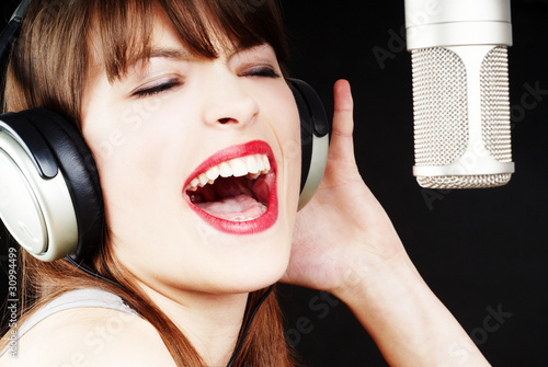 expressive woman singing to the microphone