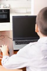Boy playing a computer