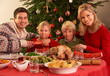 Family Enjoying Christmas Meal At Home