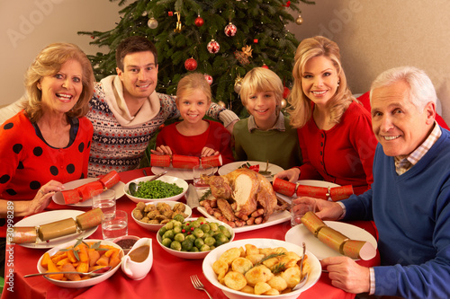 Three Generation Family Enjoying Christmas Meal At Home