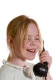 girl speaks on the old telephone