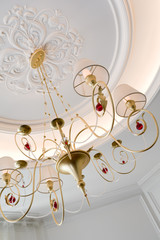 beautiful chandelier with lampshades in a room