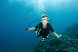 young boy has fun on a scuba dive poster