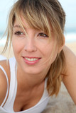 Portrait of beautiful blond woman at the beach