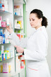Pharmacy chemist woman in drugstore