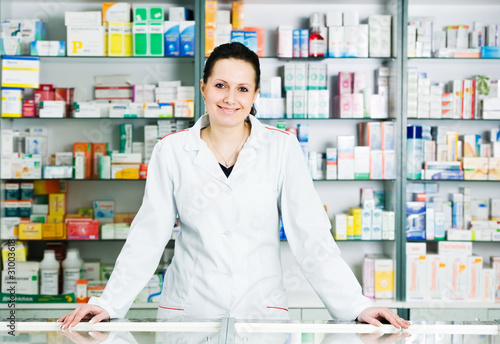 Leinwanddruck Bild Pharmacy chemist woman in drugstore